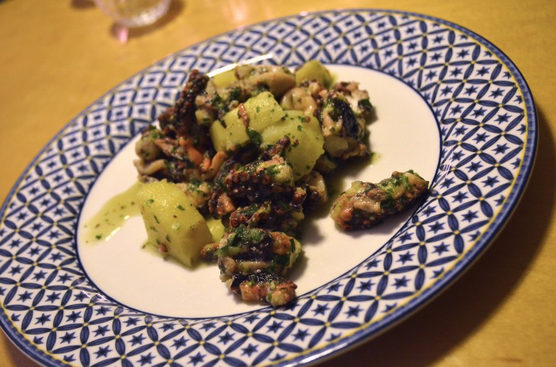 Octopus with potatoes, parsley, garlic, olive oil, and lemon juice